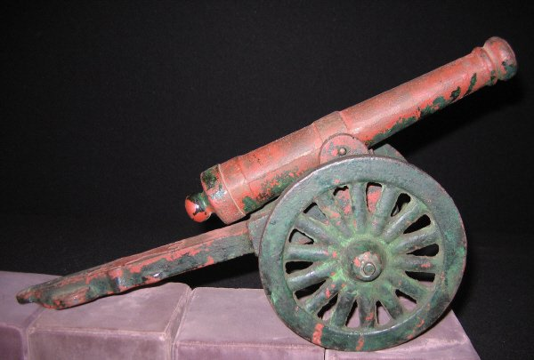 2008: Cast Iron Toy Cannon.  Red and Green paint