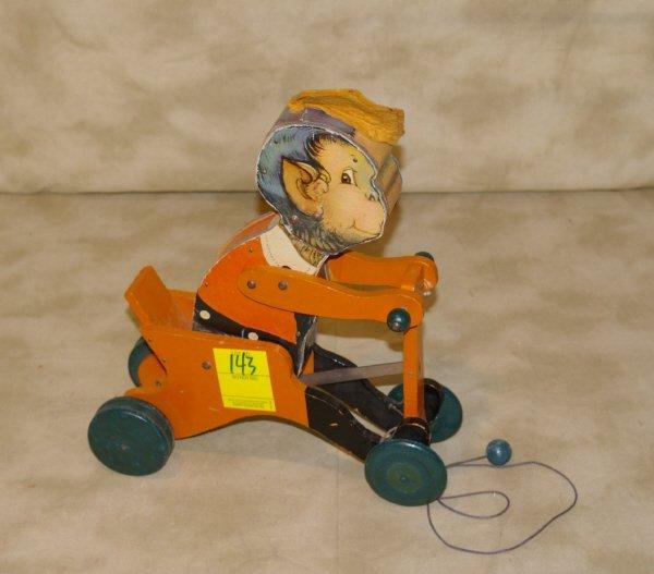 1143: Fisher Price Monkey Pull Toy