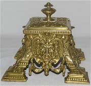 2260: Brass Footed Inkwell With Faces In The Design