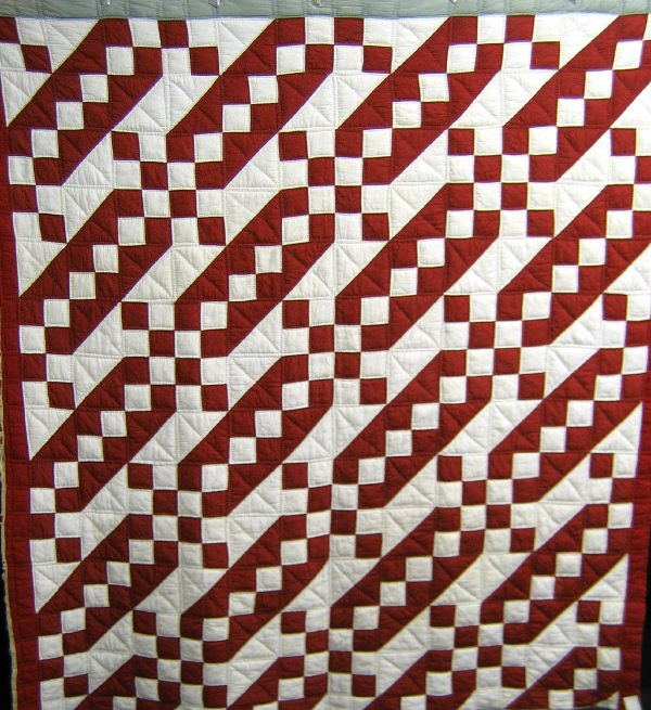 414: Quilt. Jacob's ladder. Red and white. 1900