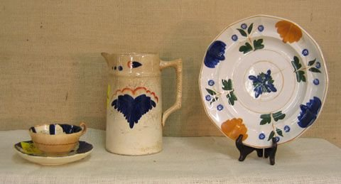 881: Gaudy Dutch china. Pitcher, Cup and Saucer, Plate