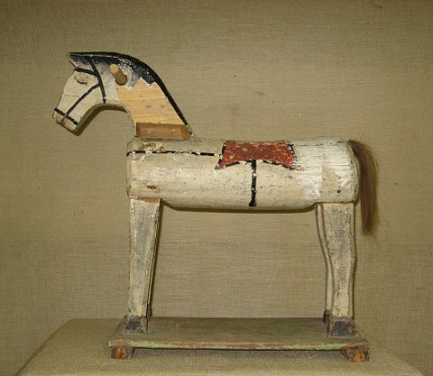 7: Wooden rocking horse. Folk art.