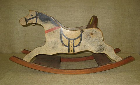 8: Child's rocking horse. solid wood construction.