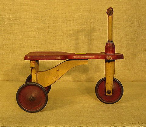 9: Child's wooden tricycle. old red and cream paint.