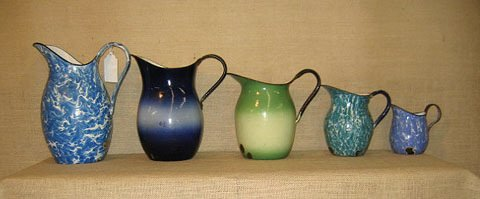 909: Graniteware. collection of 5 graduated pitchers.