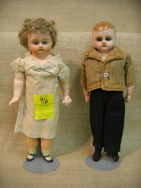 916: Pair of French composition dolls. Glass eyes.