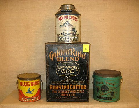 924: General store. Four general store tins.