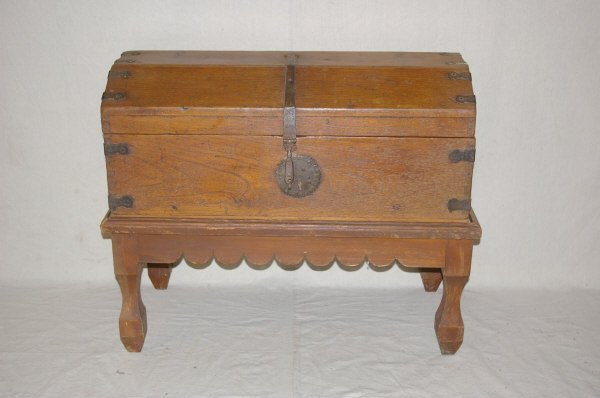 567: Primitive Hand Forged Metal Dovetailed Trunk.