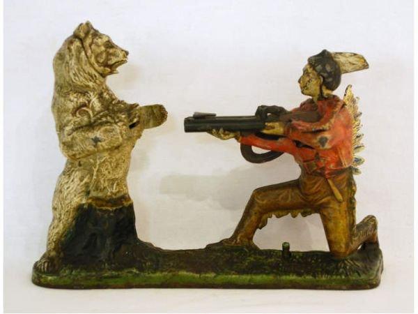 45: J E Stevens Indian Shoots Bear Mechanical Bank