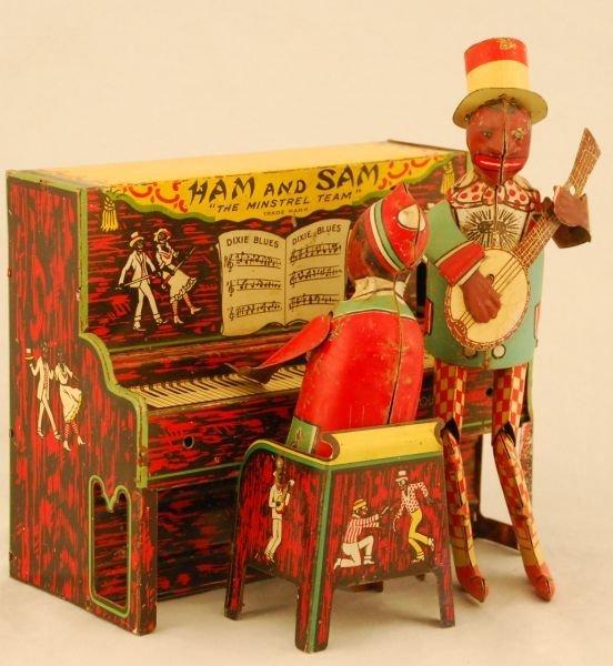 24: Strauss Ham & Sam Tin Wind Up Toy Black Americana