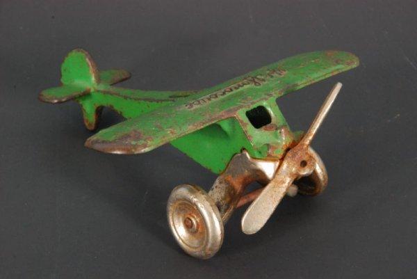 10: Arcade Monocoupe Airplane Cast Iron Toy
