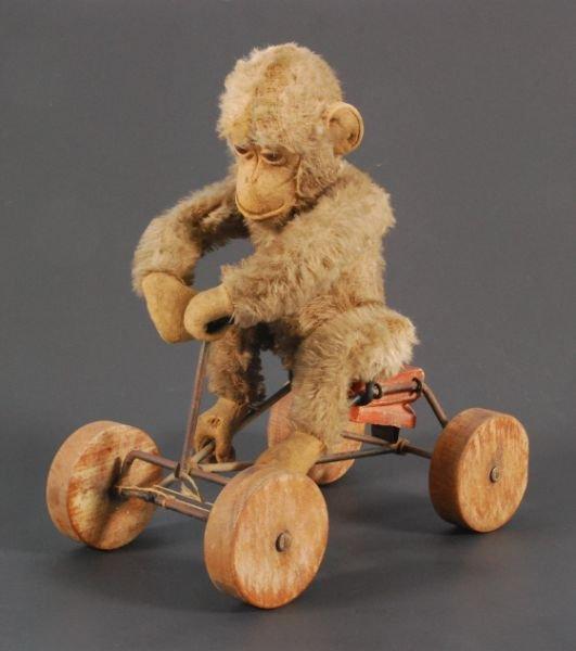 27: Steiff Monkey On Bike Pull Toy