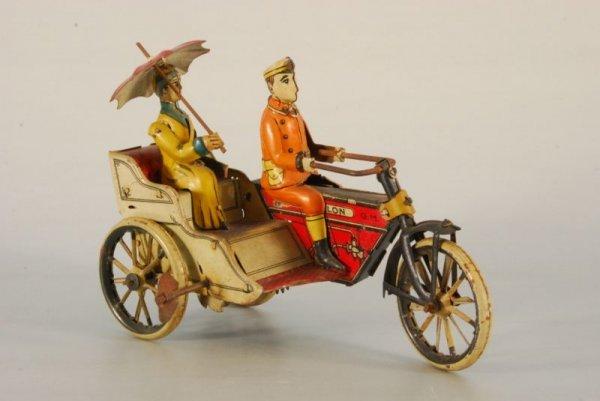 55: G & K German Tin City Cycle Toy