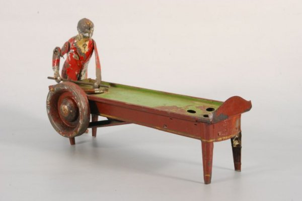 275: Early Man Shooting Pool at Table Clockwork Toy