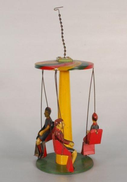 276: Buffalo Circus Swing Tin Toy