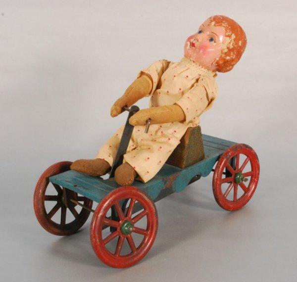 277: Girl Rider Tin Pull Toy