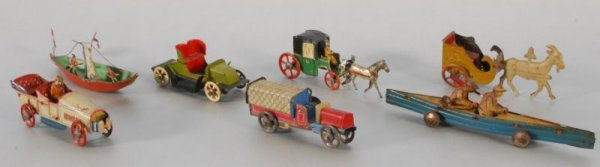 773: Collection of 7 German Penny Toys