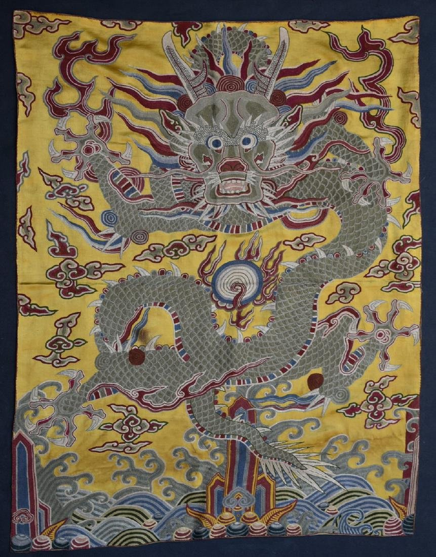 A CHINESE EMBROIDERED SILK DRAGON ROBE FRAGMENT