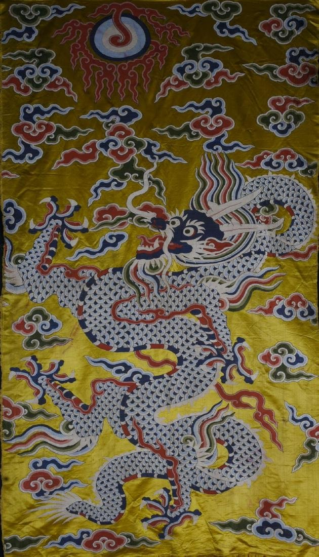 A YELLOW-GROUND EMBROIDERED DRAGON TEXTILE