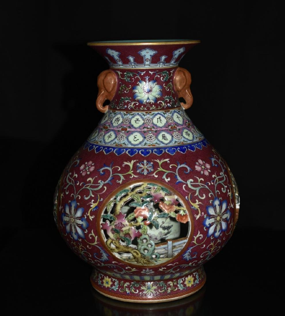 A RED-GROUND FAMILLE ROSE REVOLVING VASE, QIANLONG SIX