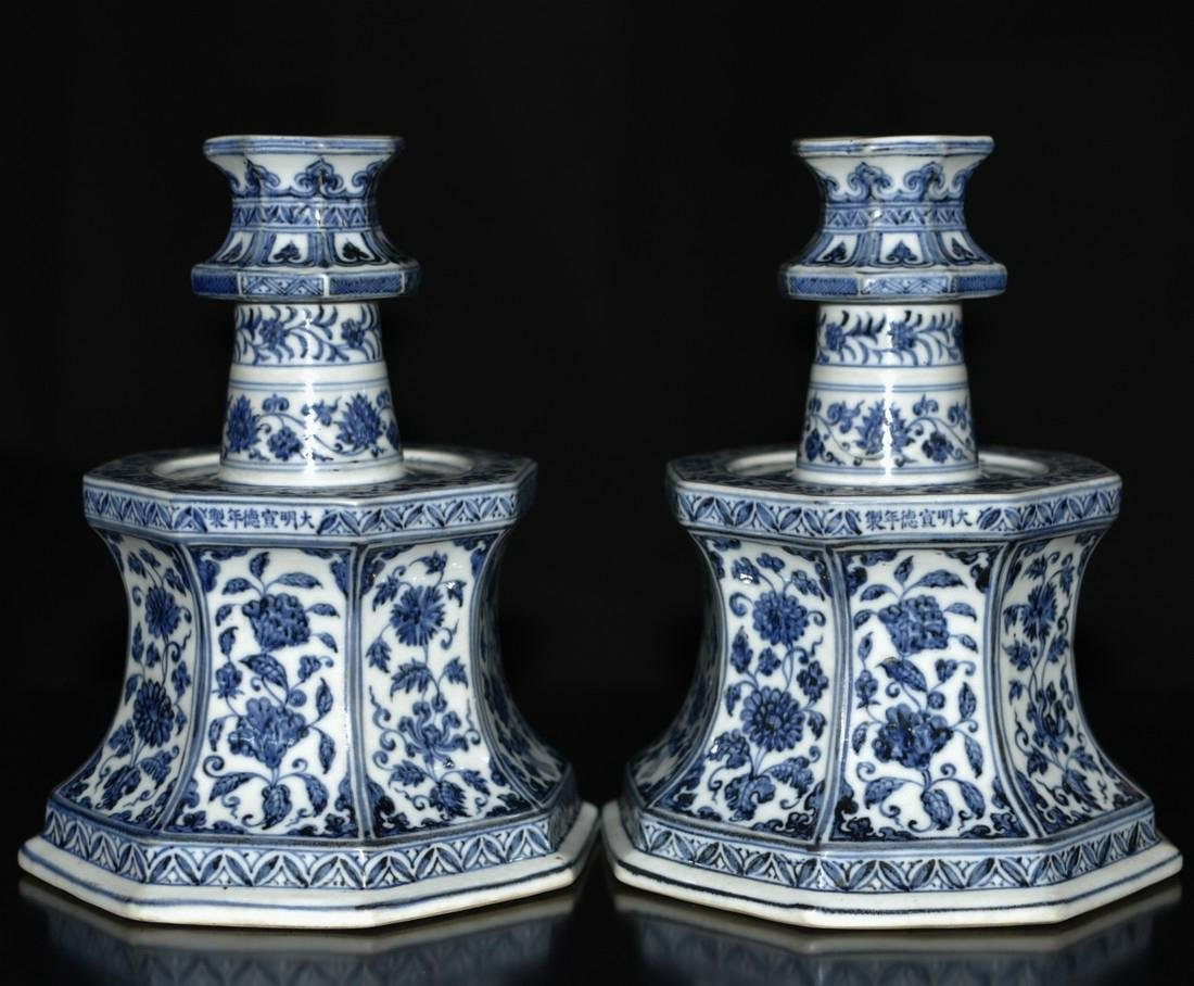A PAIR OF BLUE AND WHITE CANDLE HOLDER