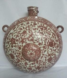 A COPPER-RED WALL VASE