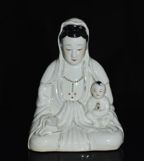 A PORCELAIN FIGURE OF GUANYIN AND A CHILD