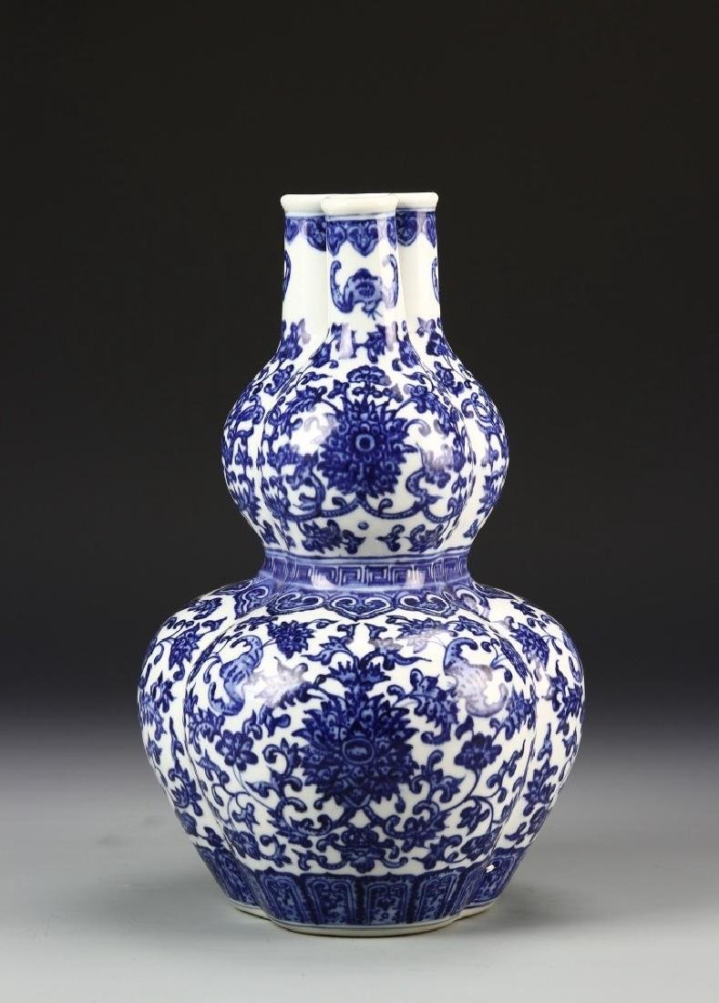 A BLUE AND WHITE THREE SPROUTS VASE, QIANLONG MARK