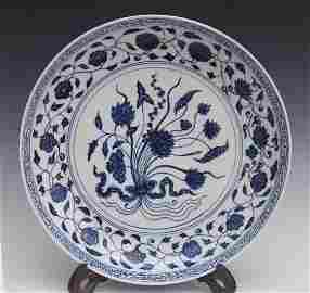 A LARGE BLUE AND WHITE PLATE