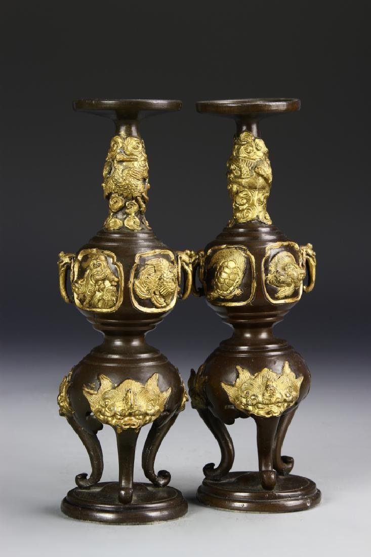 Japanese A Pair Of Gilt Bronze Candle Sticks