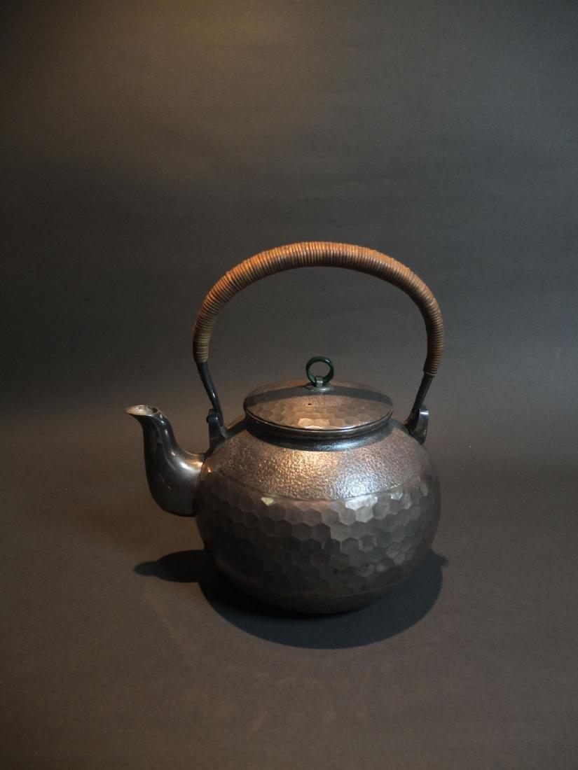 A Silver Teapot