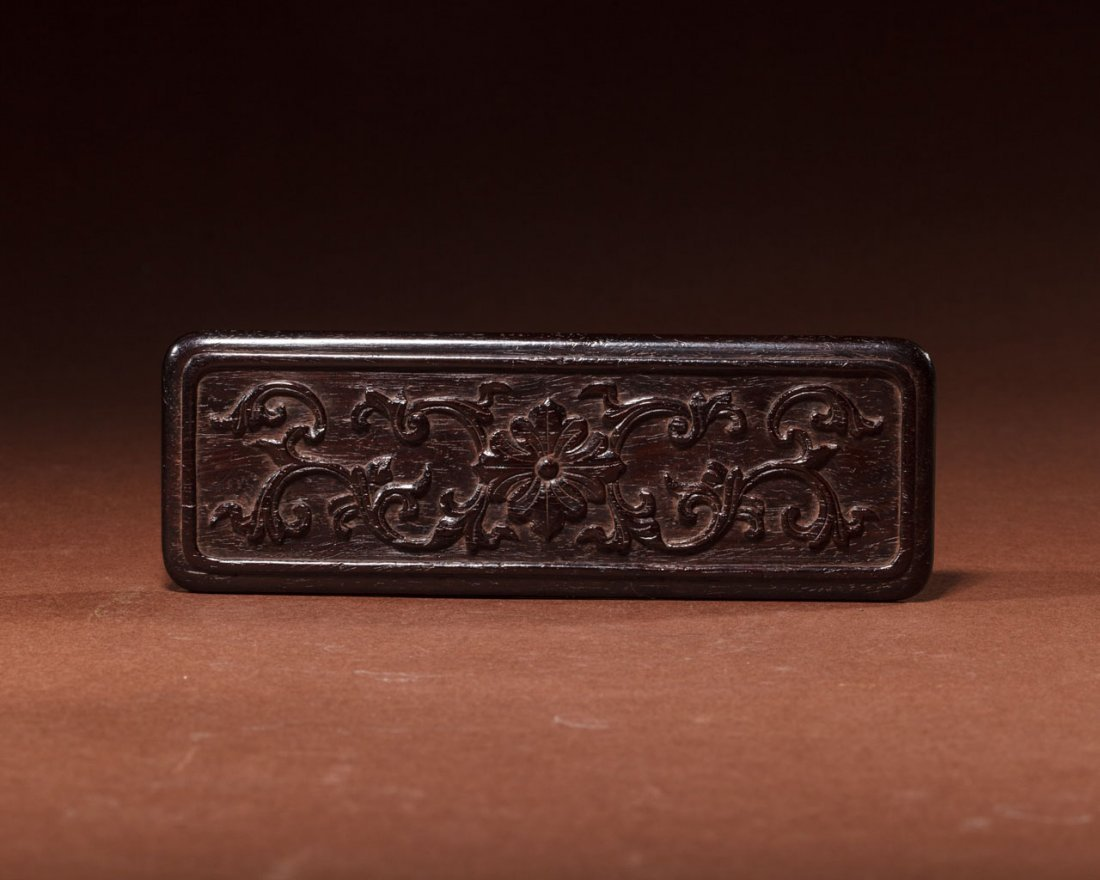 A Chinese Carved Zitan Scroll Weight