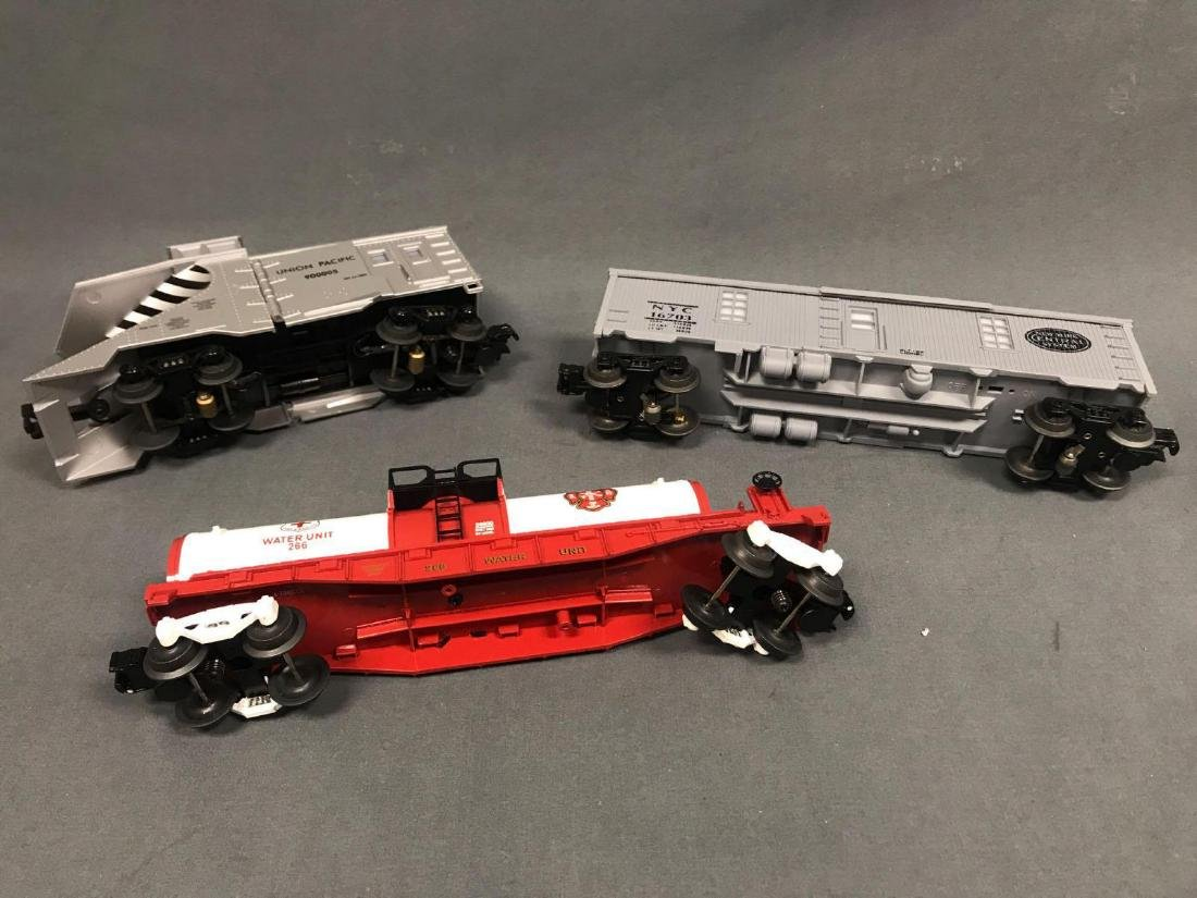 3 O Scale Lionel and MTH utility cars. Included are - 4