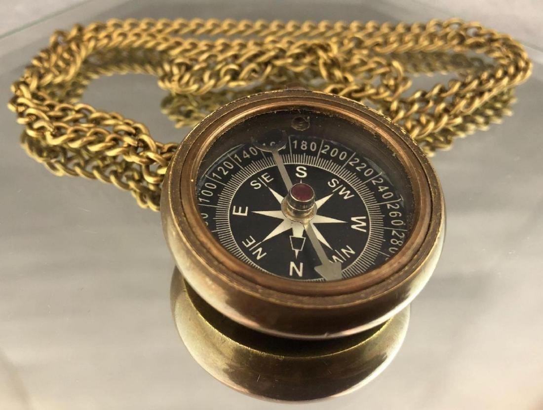 Antique bronze compass on chain