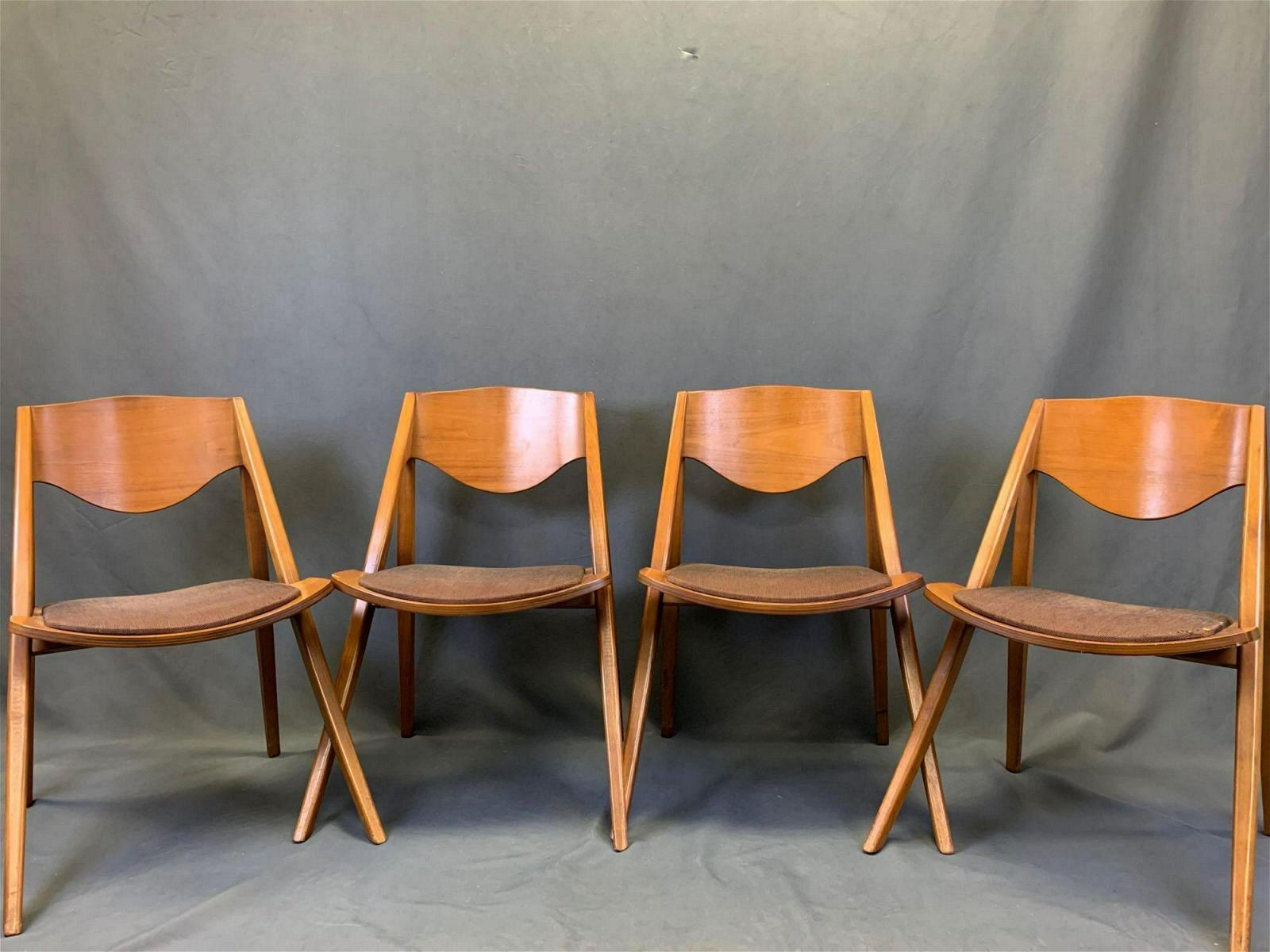 Four American Mid Century Modern Walnut Chairs