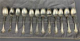 12 sterling silver spoons, 246 g