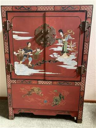 Chinese red and black lacquer cabinet.