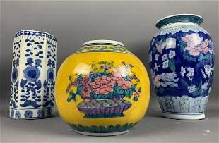 Lot of three vases: two blue, one yellow