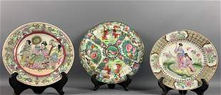 Three Asian plates with stands