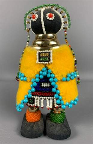Handmade, hand beaded, African doll carrying a baby on