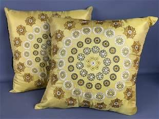 Two yellow throw pillows