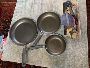 Set of three pan with utensils