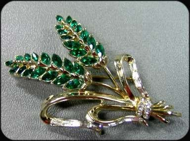 365298: CoroCraft Emerald and Gold Floral Spray Pin and