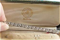 370012: diamond bar pin w/ 17 quarter carat stones