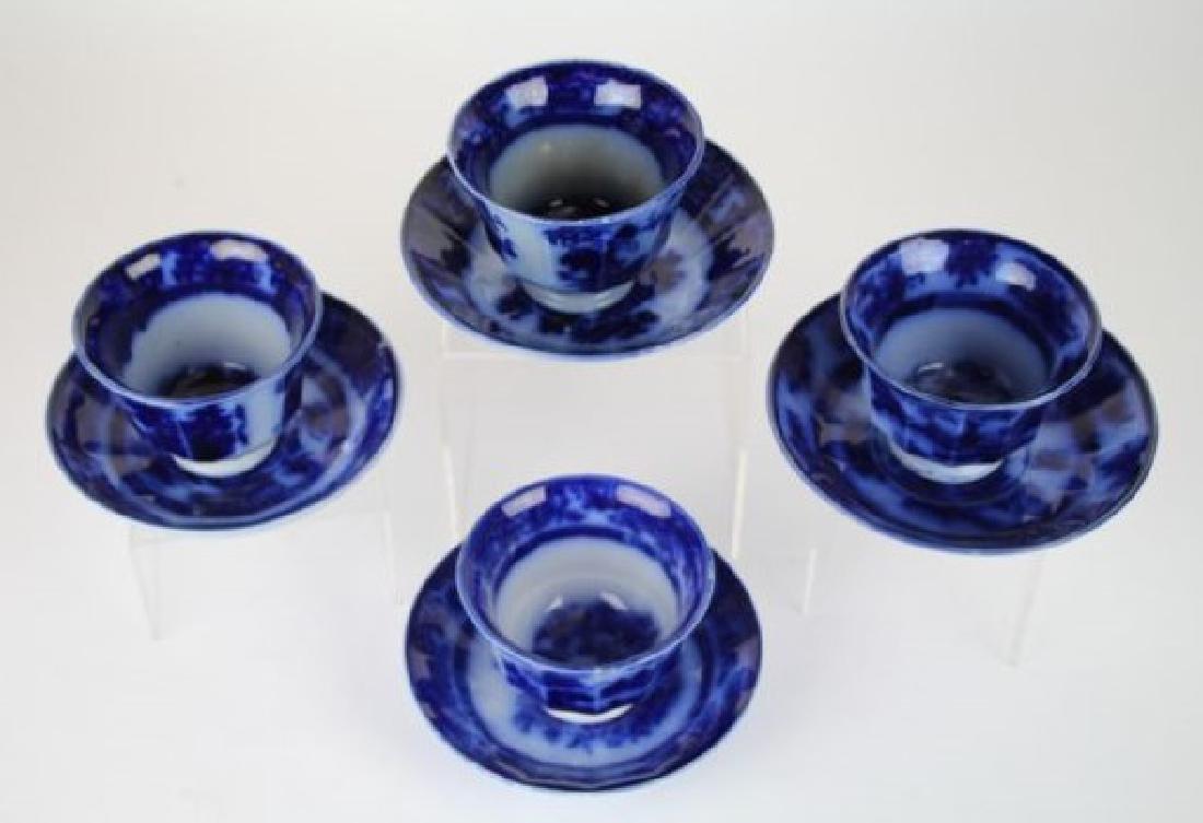 19TH C. FLOW BLUE HANDLE LESS CUPS & SAUCERS