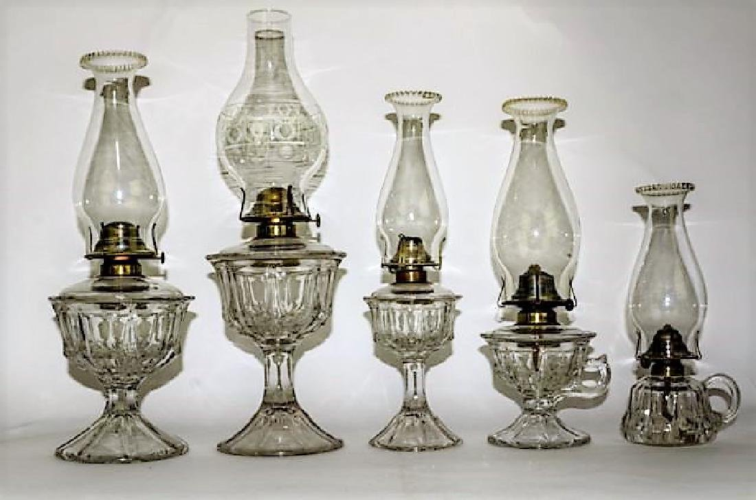 19TH CENTURY GRADUATED PARTIAL SET OF OIL LAMPS