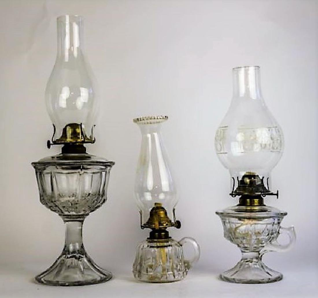 THREE 19TH CENTURY GLASS OIL LAMPS