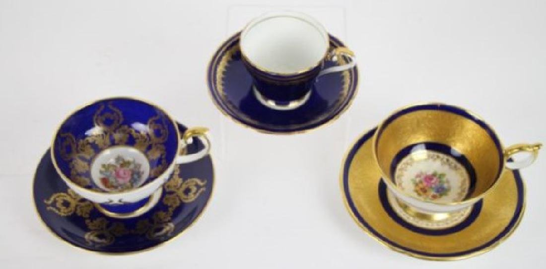 TWO AYNSLEY CUPS & SAUCERS WITH DEMI-TASSE