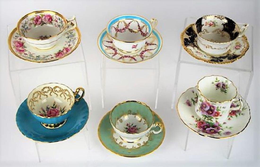 SIX ENGLISH CUPS AND SAUCERS