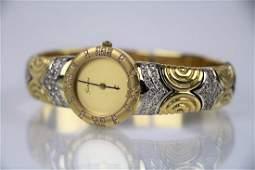LADY'S 18K GOLD GENEVE WRIST WATCH